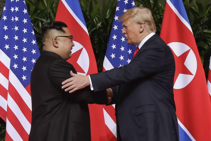 In this June 12, 2018, file photo, U.S. President Donald Trump shakes hands with North Korea leader Kim Jong-un at the Capella resort on Sentosa Island in Singapore. As they prepare to meet again, Trump is replaying many of the same moves, with a suspenseful buildup, make-or-break stakes and dramatic rendezvous in a far-flung locale. AP