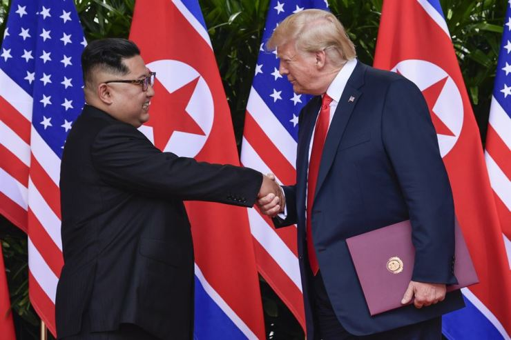 In this June 12, 2018 file photo, North Korea leader Kim Jong-un and U.S. President Donald Trump shake hands at the conclusion of their meetings at the Capella resort on Sentosa Island Tuesday, June 12, 2018 in Singapore. AP-Yonhap