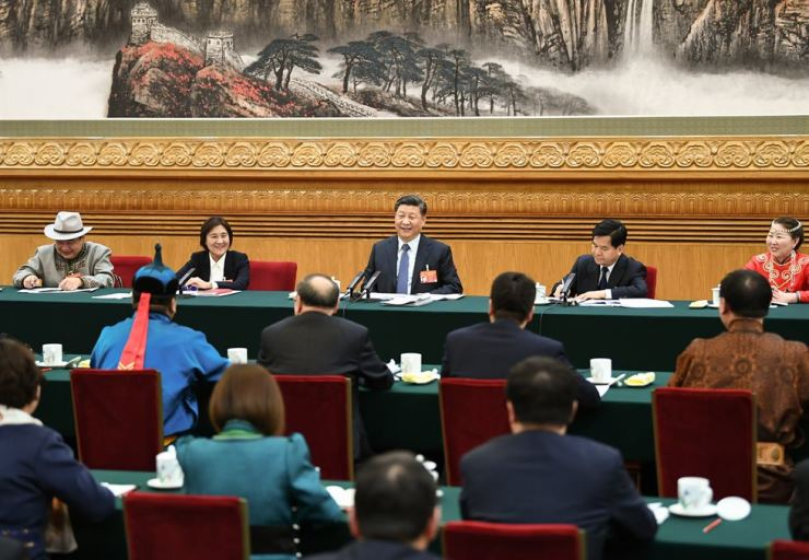 Chinese President Xi Jinping, also general secretary of the Communist Party of China (CPC) Central Committee and chairman of the Central Military Commission, attends a panel discussion with his fellow deputies from Inner Mongolia Autonomous Region at the second session of the 13th National People's Congress in Beijing, capital of China, March 5, 2019. Xinhua-Yonhap