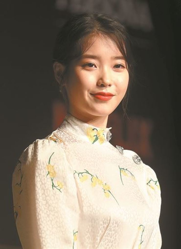 K-pop singer and actress Lee Ji-eun, a.k.a. IU, poses during a press event for her debut film 'Persona' at Conrad Seoul, Wednesday. / Yonhap