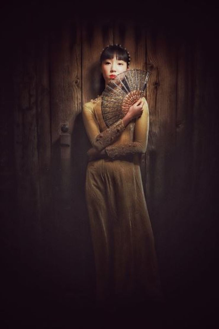 Korean model Dahye Lee (Instagram @ssoodor) models a modern Vietnamese ao dai dress from Hanoi designer and brand Le Lam in front of a traditional Korean wooden door in the Insadong district in central Seoul.