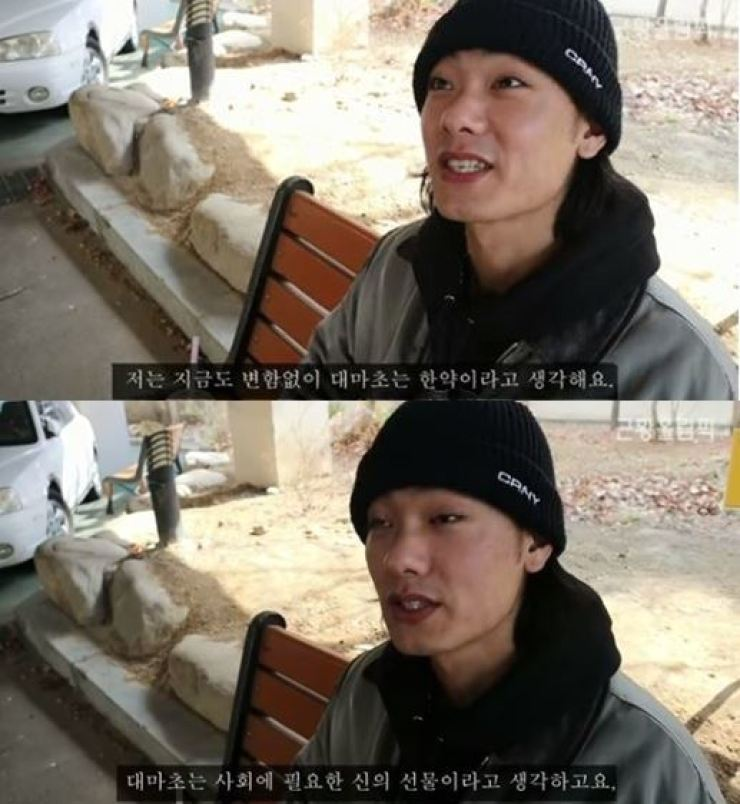 Footage from YouTube shows rapper Iron praising marijuana while doing community service as part of a penalty for beating up his girlfriend and smoking pot.