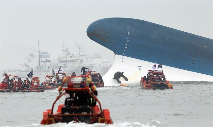 The sinking Sewol ferry is surrounded by maritime police boats off the coast of Jindo, South Jeolla Province, April 16, 2014. / Yonhap.