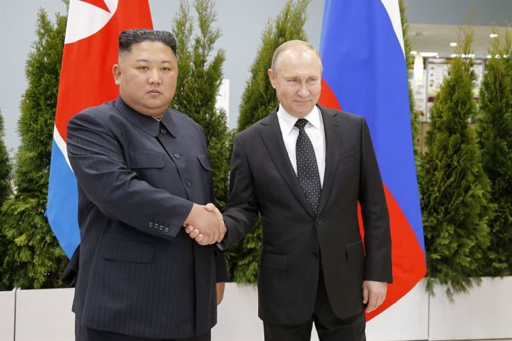 North Korean leader Kim Jong-un shakes hands with Russian President Vladimir Putin at the Far Eastern Federal University in Vladivostok, Thursday, before their first ever summit. AP-Yonhap