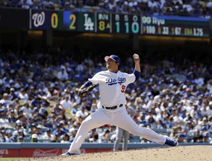 Los Angeles Dodgers starting pitcher Hyun-Jin Ryu throws to the Washington Nationals during the eighth inning of a baseball game Sunday, May 12, 2019, in Los Angeles. (AP Photo/Marcio Jose Sanchez)