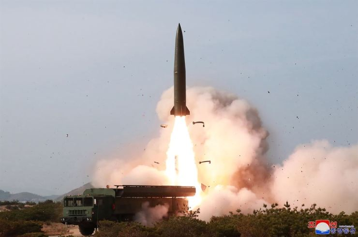 A rocket blasts off from a mobile launcher in this photo North Korea's state media KCNA released on Sunday, a day after the nuclear-armed North fired multiple short-range projectiles into the East Sea. Yonhap