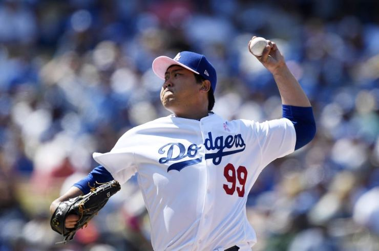 Pitcher Hyun-Jin Ryu #99 of the Los Angeles Dodgers throws a pitch against the Washington Nationals during the seventh inning at Dodger Stadium on May 12, 2019 in Los Angeles, California. Kevork Djansezian/Getty Images/AFP