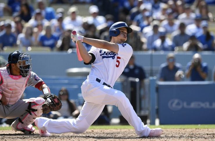 Corey Seager #5 of the Los Angeles Dodgers hits a grand slam against relief pitcher Kyle Barraclough of the Washington Nationals during the eighth inning at Dodger Stadium on May 12, 2019 in Los Angeles, California. Kevork Djansezian/Getty Images/AFP