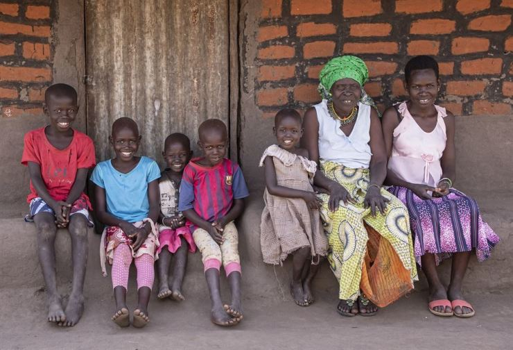 Family members in an unnamed village of Uganda pose in this 2018 photo. Photographer Cho Jang-sok has taken photos of African people since 2015. Under a partnership with Korea Foundation, Cho will embark on a family photo project to Ethiopia, Uganda and Madagascar starting May 9. / Courtesy of Cho Jang-sok