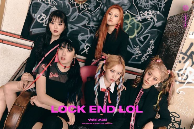 Weki Meki members pose for the 'LOL' version of themselves, showing each member's characters liberated from their locked selves at school. The photo concept is members of an after-school band. Courtesy of Fantagio Corp.