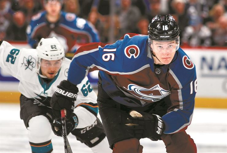Colorado Avalanche defenseman Nikita Zadorov, front, and San Jose Sharks right wing Kevin Labanc pursue the puck during the second period of Game 3 of an NHL hockey second-round playoff series in Denver, Tuesday. AP-Yonhap