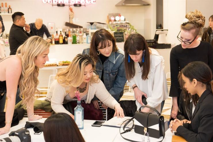 Judy Kim working with beauty influencers during a brunch event. Courtesy of SOAK