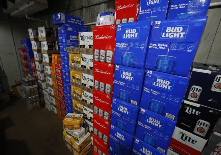 Cases of beer are stacked inside a walk-in cooler at Franklin Liquors in Franklin, Massachusetts, USA, May 10. EPA-Yonhap