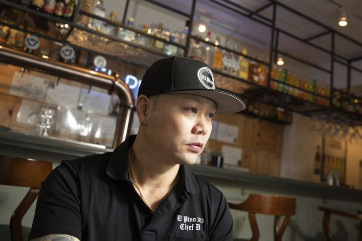 Korean-American chef Christian Morales, better known by his nickname 'Chef D,' listens to a question during an interview with The Korea Times at his restaurant El Pino 323 in Itaewon, Seoul, Wednesday. / Korea Times photo by Choi Won-suk