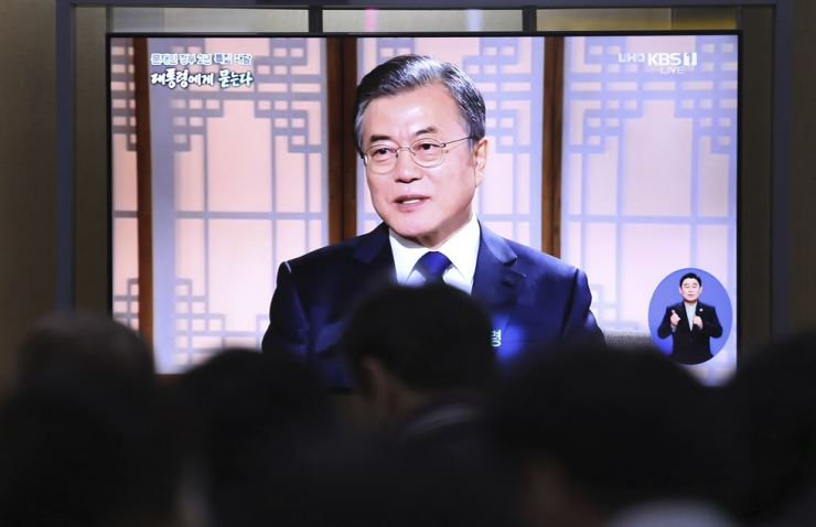 People watch a TV screen showing a live broadcast of President Moon Jae-in during a TV talk show at the Seoul Railway Station in Seoul, Thursday, May 9, 2019. AP-Yonhap