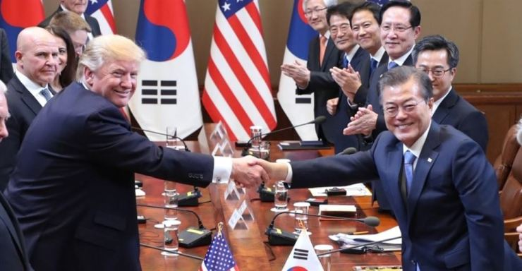 President Moon Jae-in shakes hands with U.S. President Donald Trump during an expanded summit with their, at Cheong Wa Dae in November 2017. Yonhap