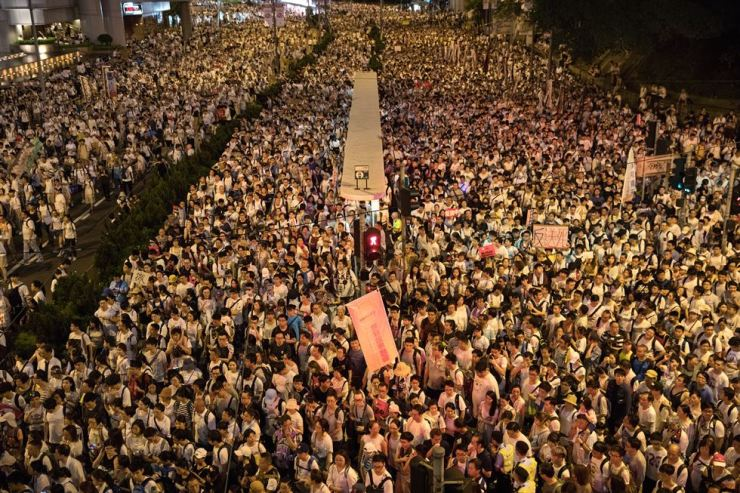 Thousands of protesters take part in a march against amendments to an extradition bill in Hong Kong, June 9. The bill, which has faced immense opposition from pan-democrats, the business sector, and the international community, would allow the transfer of fugitives to jurisdictions which Hong Kong does not have a treaty with, including mainland China. Critics of the bill have expressed concern over unfair trials and a lack of human rights protection in mainland China. EPA