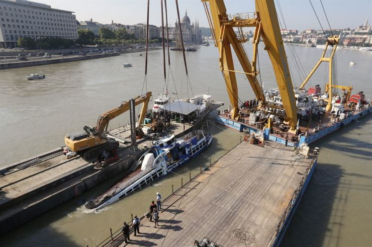 A crane lifts the boat out of the Danube river in Budapest, Hungary, June 11. MTI via AP