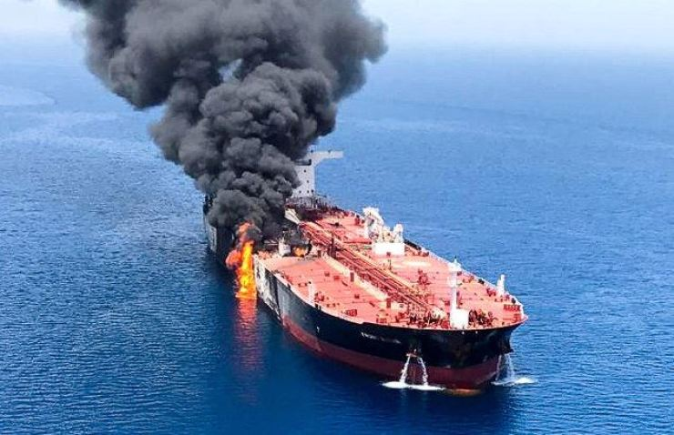 An oil tanker is seen after it was attacked at the Gulf of Oman, in waters between Gulf Arab states and Iran, June 13. Reuters-Yonhap