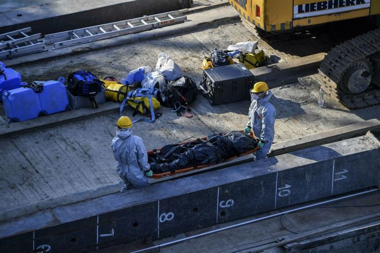 A body is carried away during the recovery operation at Margaret Bridge, the scene of the fatal boat accident in Budapest, Hungary, June 11. AP