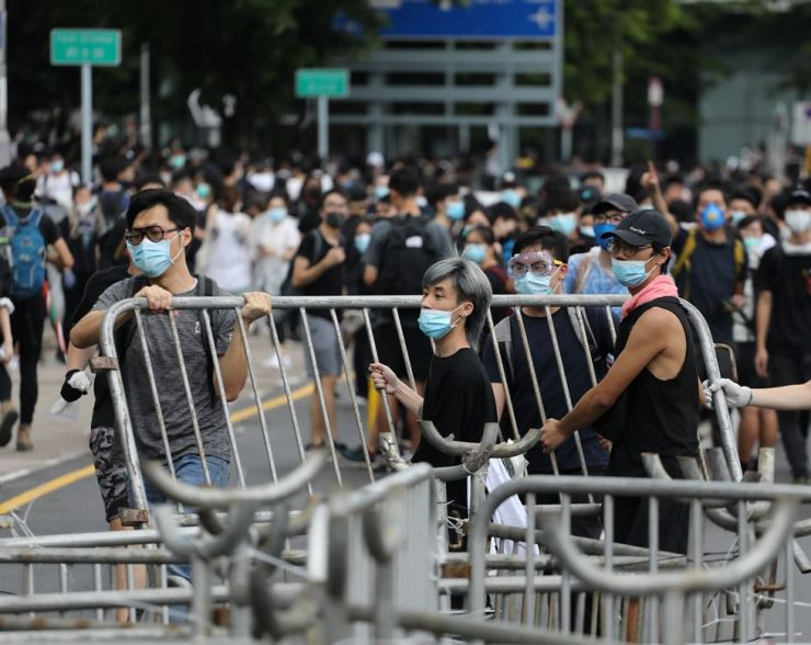 Demonstrators remove metal barricades during a protest against a proposed extradition bill in Hong Kong in Hong Kong, China, June 12. Reuters-Yonhap