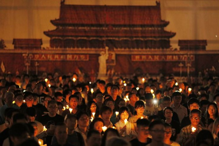Thousands of people attend a candlelight vigil for victims of the Chinese government's brutal military crackdown three decades ago on protesters in Beijing's Tiananmen Square at Victoria Park in Hong Kong, June 4. Hong Kong is the only region under Beijing's jurisdiction that holds significant public commemorations of the 1989 crackdown and memorials for its victims. Hong Kong has a degree of freedom not seen on the mainland as a legacy of British rule that ended in 1997. AP