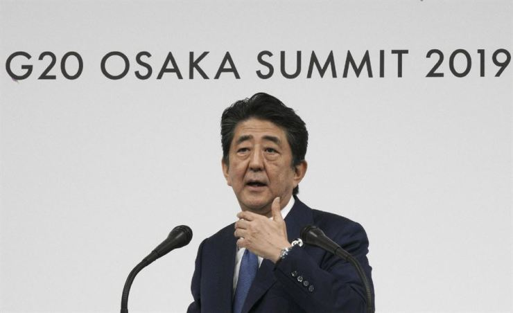 Japanese Prime Minister Shinzo Abe speaks during a press conference after the G20 summit in Osaka, Saturday. / AP-Yonhap
