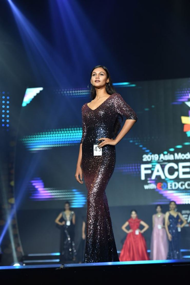 Shrin Akther, who represented Bangladesh, poses in an evening dress in the Face of Asia contest held on Friday in Seoul. / Courtesy of AMFOC