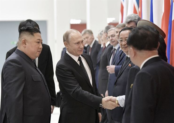 Russian President Vladimir Putin, second left, and North Korea's leader Kim Jong-un, left, greet North Korea's delegation prior to their talks in Vladivostok, Russia, April 25, 2019. AP-Yonhap