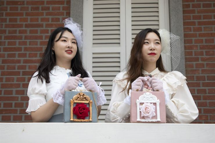 Women in 19th century-style fancy dresses visit Incheon to find perfect spots for photos. / Korea Times photo by Choi Won-suk