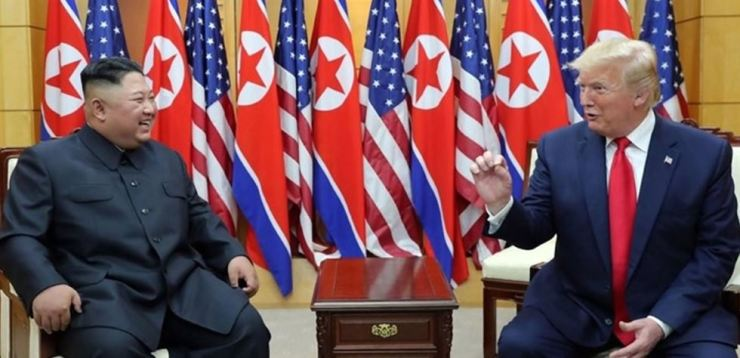 U.S. President Donald Trump and North Korean leader Kim Jong-un hold a