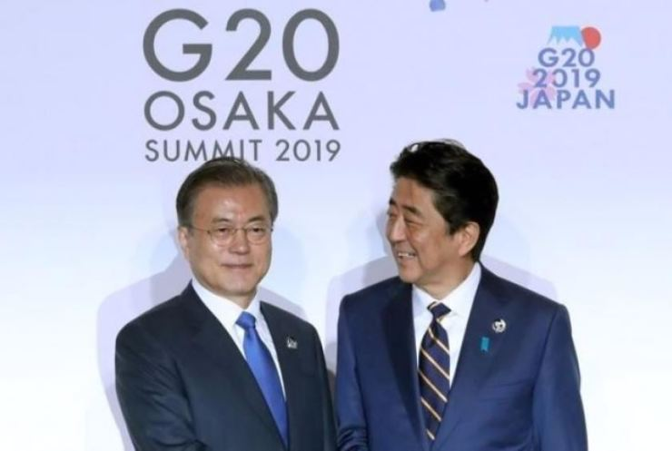 President Moon Jae-in and Japan's Prime Minister Shinzo Abe during the G20 summit in Osaka, Japan. AP-Yonhap
