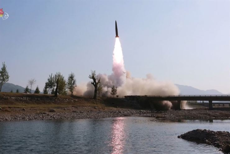 North Korea fired two unidentified projectiles from Wonsan, Gangwon Province, into the East Sea on Thursday morning, according to South Korea's Joint Chiefs of Staff. In the photo released by North Korean state-run Korean Central Television, a North Korean missile is being launched from a transporter erector launcher on May 9, 2019. Yonhap