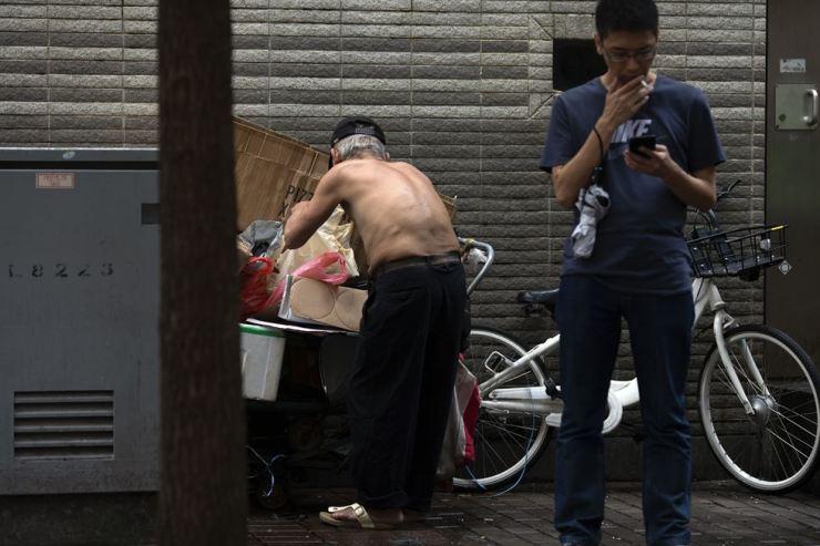 A man rummages through trash on Thomson Road in Wan Chai, Hong Kong, July 4. Korea Times photo by Choi Won-suk