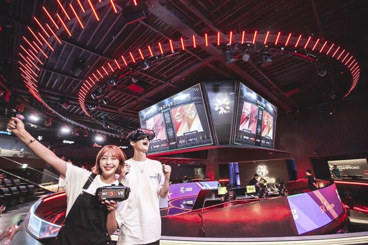 Models promote SK Telecom's AR and VR services designed to offer more immersive viewing experiences for esports fans at LoL Park in Seoul in this photo provided by the mobile carrier, Friday. / Courtesy of SK Telecom