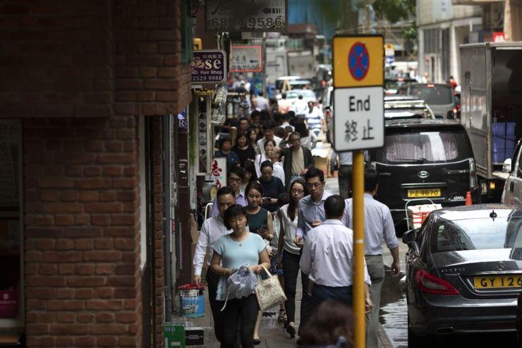 People walk down Thomson Road in Wan Chai, Hong Kong, July 4. Korea Times photo by Choi Won-suk