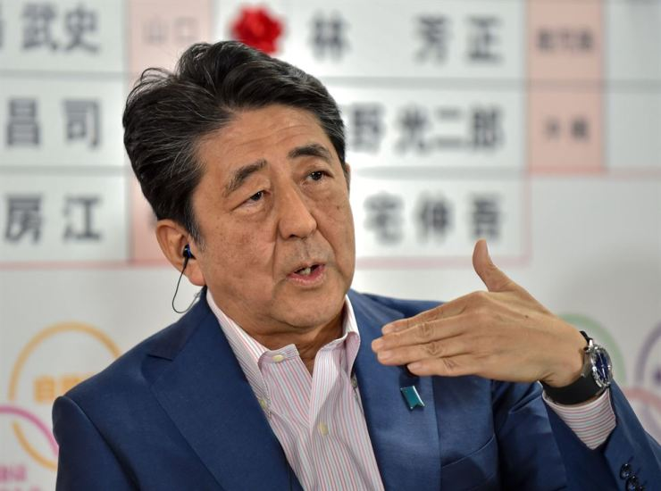 Japanese Prime Minister and ruling Liberal Democratic Party President Shinzo Abe gestures as he answers questions during a television interview following Parliament's upper house election at the party's headquarters in Tokyo, Sunday. AFP-Yonhap