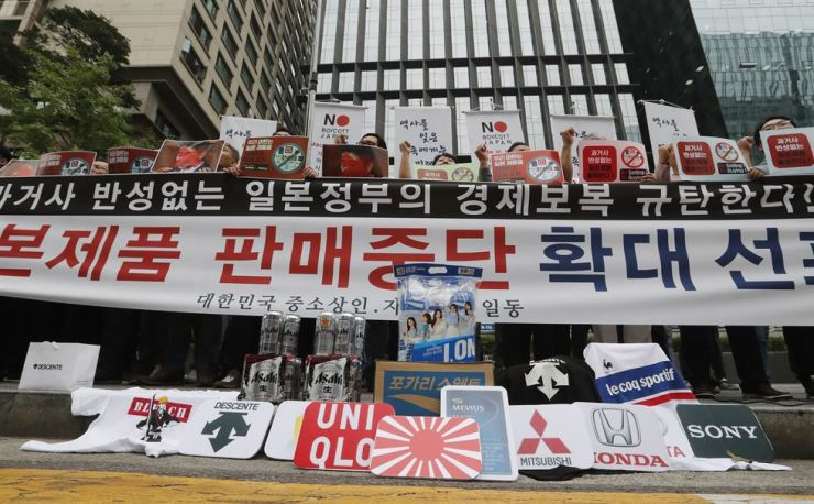 South Korean small and medium-sized business owners stage a rally calling for a boycott of Japanese products in front of the Japanese embassy in Seoul, South Korea, Monday, July 15, 2019. South Korea and Japan last Friday, July 12, failed to immediately resolve their dispute over Japanese export restrictions that could hurt South Korean technology companies, as Seoul called for an investigation by the United Nations or another international body. The signs read: 'Our supermarket does not sell Japanese products.' (AP Photo/Ahn Young-joon)