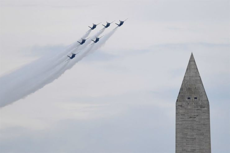 The U.S. Navy Blue Angels fly past the Washington Monument as U.S. President Donald Trump speaks during an Independence Day celebration in front of the Lincoln Memorial in Washington DC, July 4. Reuters