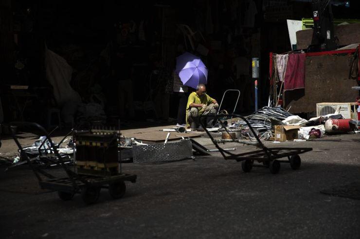 A man collects garbage scraps on Fuk Wing Street in Sham Shui Po, Hong Kong, July 4. Korea Times photo by Choi Won-suk