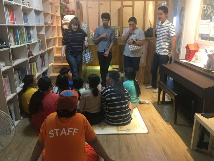 Beyond the English Divide (BtED) volunteers interact with children at Dolsan Child Community Center on June 22. / Courtesy of Beyond the English Divide