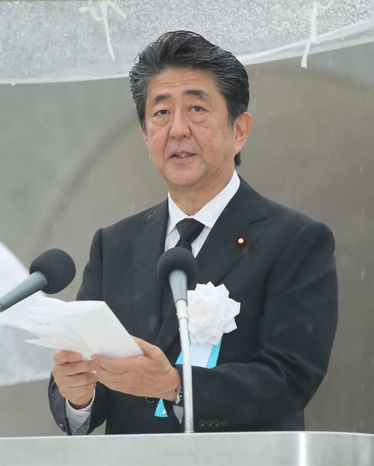 Japan's Prime Minister Shinzo Abe delivers a speech during a ceremony for victims of the Aug. 6, 1945 atomic bombing at Hiroshima Peace Memorial Park in Hiroshima, western Japan, Tuesday. The citizens of Hiroshima marked the 74th anniversary of the bombing. EPA