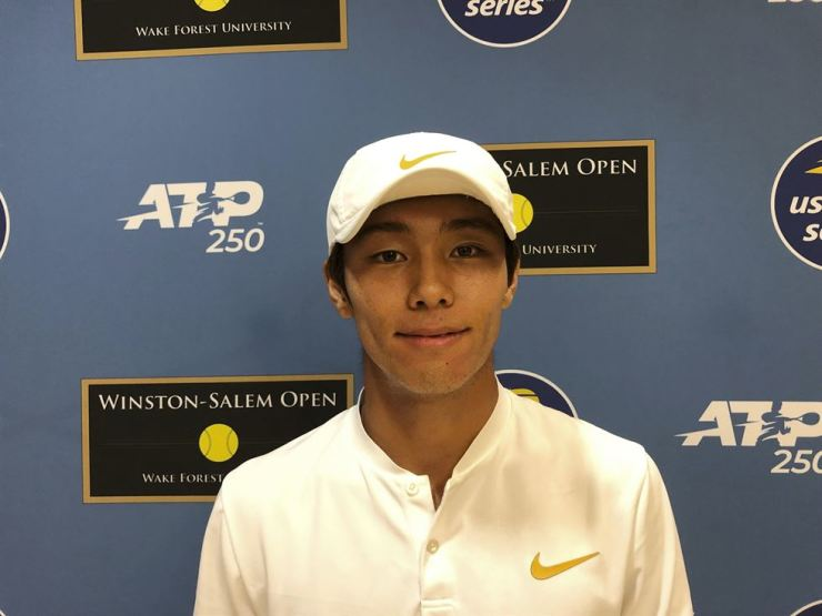 Tennis player Lee Duck-hee of Korea poses following his tennis match, Monday, Aug. 19, 2019, at the Winston-Salem Open in Winston-Salem, N.C. Lee became the first deaf professional to play in an ATP-level tennis tournament. AP