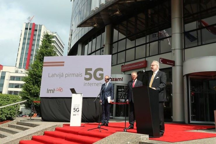 Latvian President Egils Levits, right, delivers a speech during a ceremony to mark the Baltic state's launch of its 5G mobile network on July 19. The launch was among the latest developments in Latvia's digital technology sector. / Embassy of Latvia