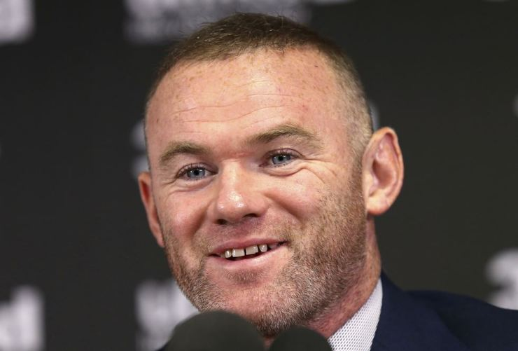 Britain soccer player Wayne Rooney speaks, during a press conference, at Pride Park, in Derby, England, Tuesday. Rooney will be leaving Major League Soccer after less than two seasons to return to play in England and be closer to his family.The 33-year-old former England captain will remain at D.C. United until the end of the season before joining second-tier Championship team Derby County as player-coach from January. /AP-Yonhap