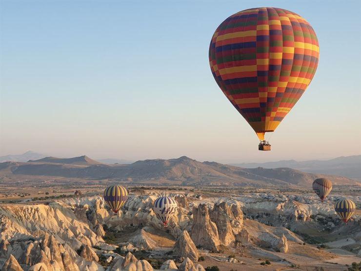 Hot air balloons floats high above the sky over Cappadocia, Turkey on July, 24. Korea Times photo by Kim Hyun-bin