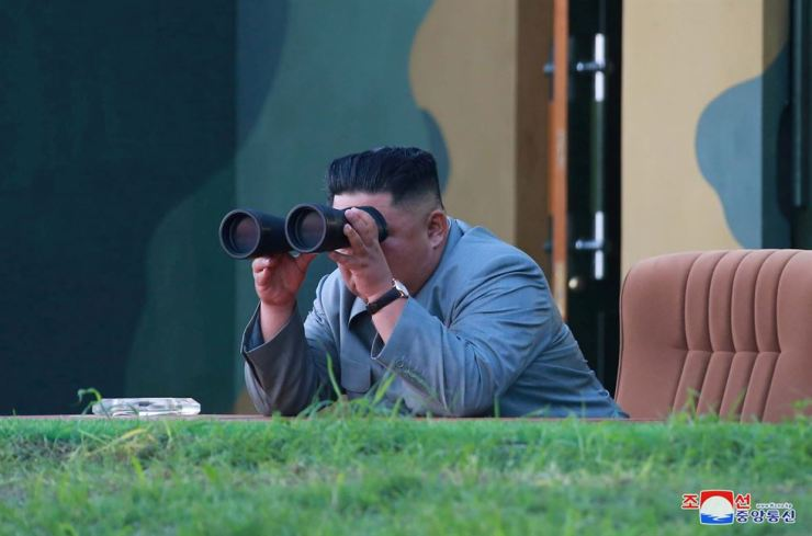 North Korean leader Kim Jong-un watches the test-fire of two short-range ballistic missiles on Thursday, in this undated picture released by North Korea's Central News Agency on July 26. Reuters