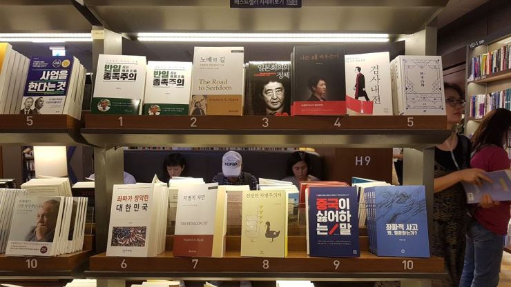 Five out of the top 10 best-selling books in the fields of politics and society are written by conservative authors or those who are highly critical of the liberal Moon Jae-in government. / Korea Times