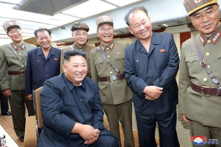 North Korean leader Kim Jong-un guides the test firing of a new weapon, in this undated photo released on Aug. 11, 2019, by North Korea's Korean Central News Agency. Yonhap