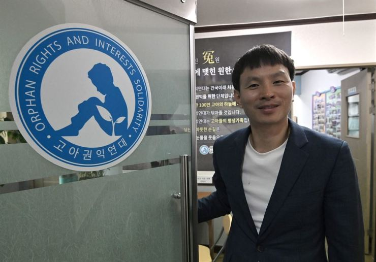 This picture taken on August 8, 2019 shows Jo Youn-hwan, a South Korean who grew up in an orphanage and last year set up the South's first-ever orphan rights group, posing during an interview with AFP at his office in Seoul. - Abandoned children face lifelong stigma in South Korea, seen as being the result of a morally culpable unmarried relationship and not having the known ancestors of a family line. (Photo by Jung Yeon-je / AFP)